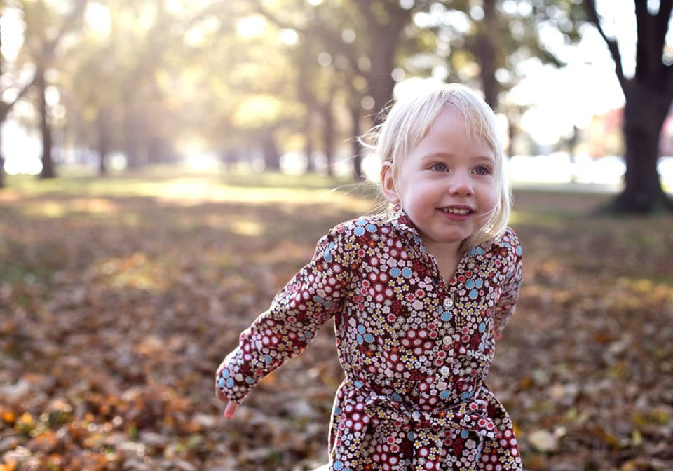 Portrait of a young girl enjoying the Autumn Leaves; Family Portraits Christchurch