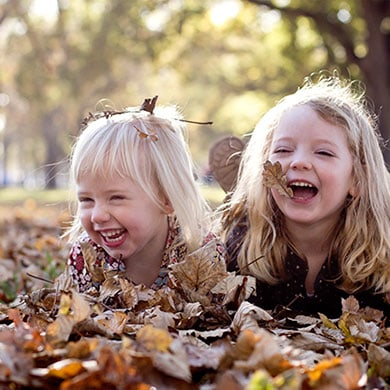 Playing in the Autumn Leaves, the best fun for a Family Portrait