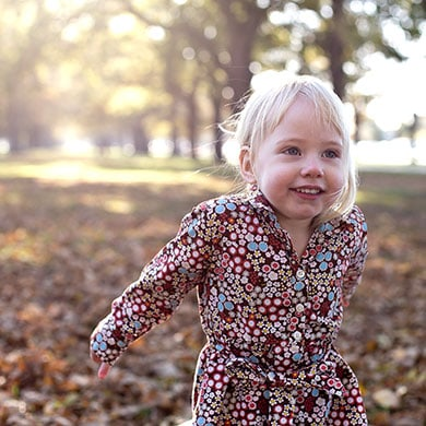 Portrait of a young girl enjoying the Autumn Leaves