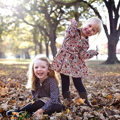Sisters enjoying Autumn Leaves